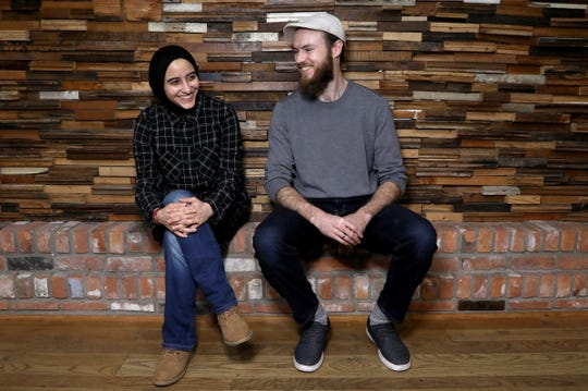 LaunchGood.com co-founder and COO Amany Killawi and co-founder and CEO Chris Blauvelt pose for a photo inside Green Garage, the workspace they share with other small businesses in Detroit, Michigan on Tuesday, March 19, 2019. Their website, crowdfunded $1.6 million in donations for the victims of the Christchurch, New Zealand.