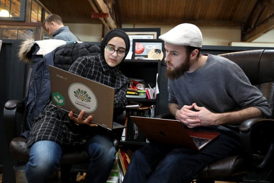 LaunchGood.com co-founder and COO Amany Killawi and co-founder and CEO Chris Blauvelt work inside Green Garage, the workspace they share with other small businesses in Detroit, Michigan on Tuesday, March 19, 2019. Their website, crowdfunded $1.6 million in donations for the victims of the Christchurch, New Zealand.
