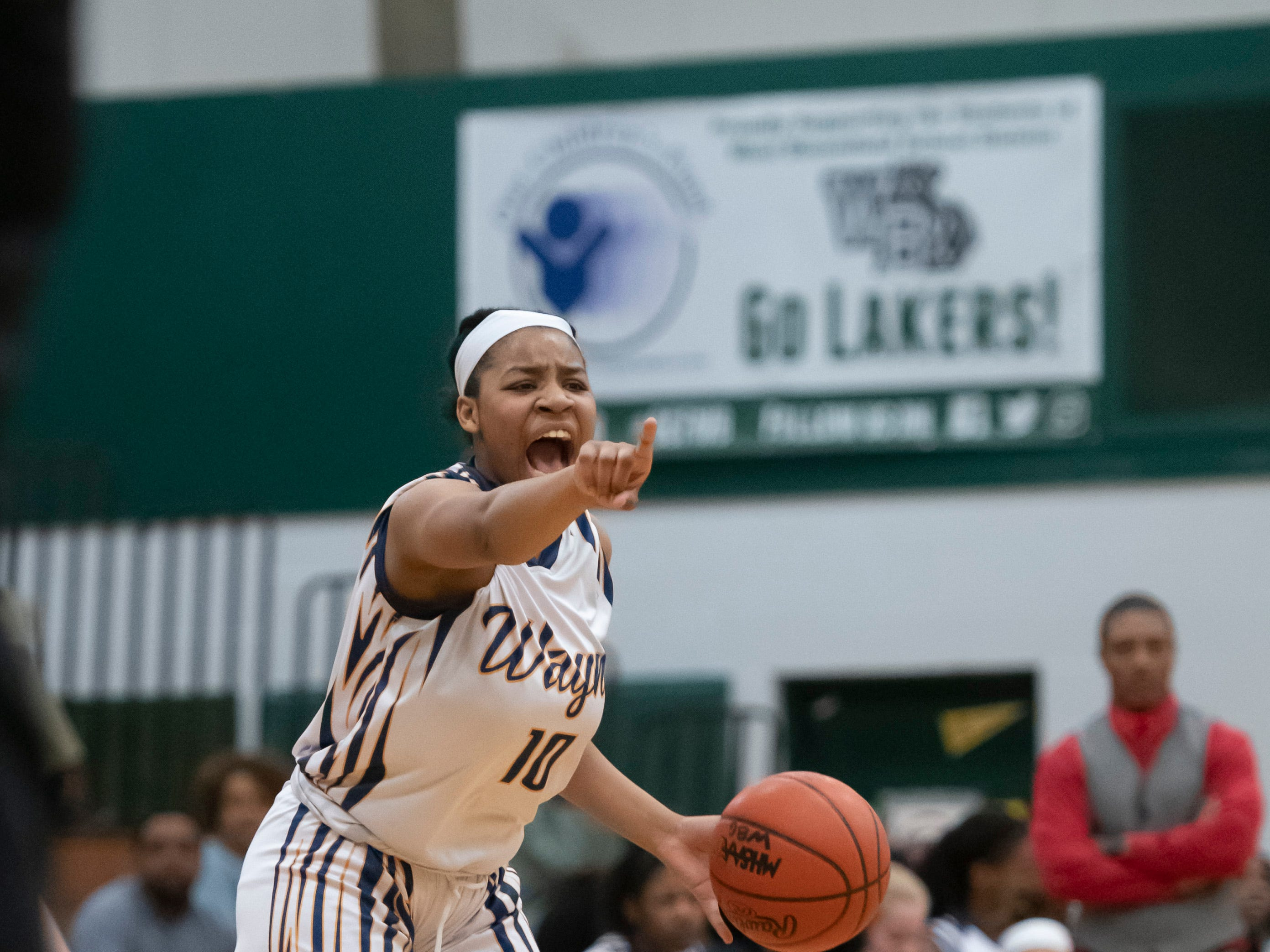 Wayne Memorial guard Jeanae Terry shouts out a play to her teammates during the first half.