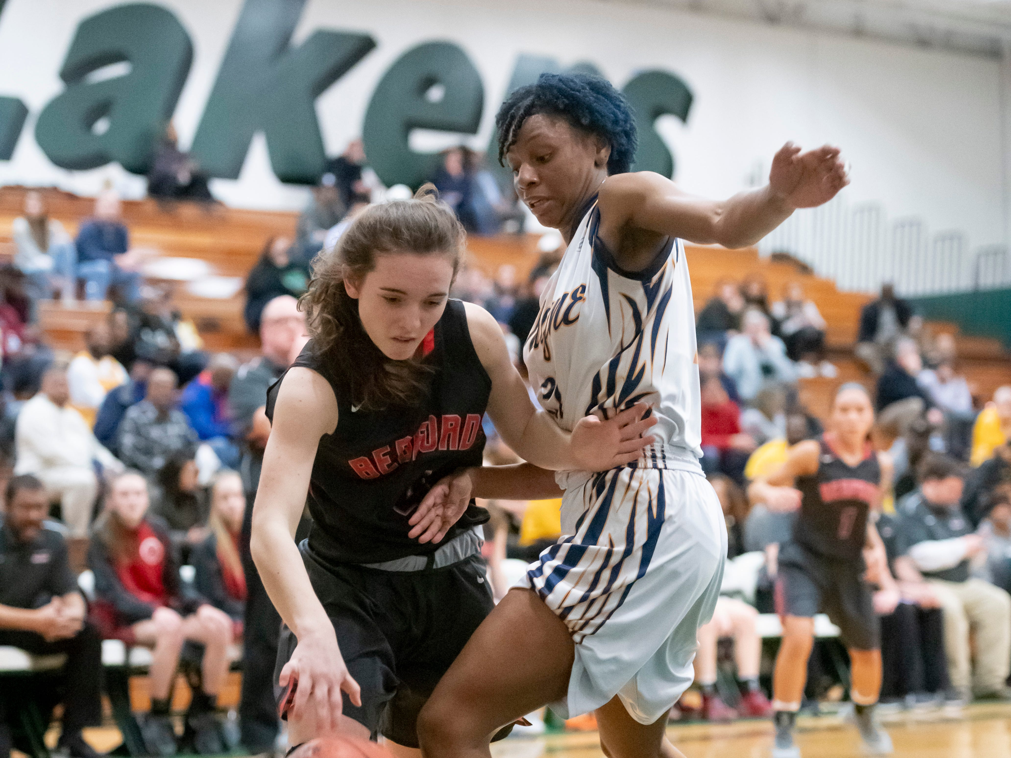 Bedford's Savanana Killinen tries to push the ball past Wayne Memorial guard Sammiyah Hoskin in the first half.