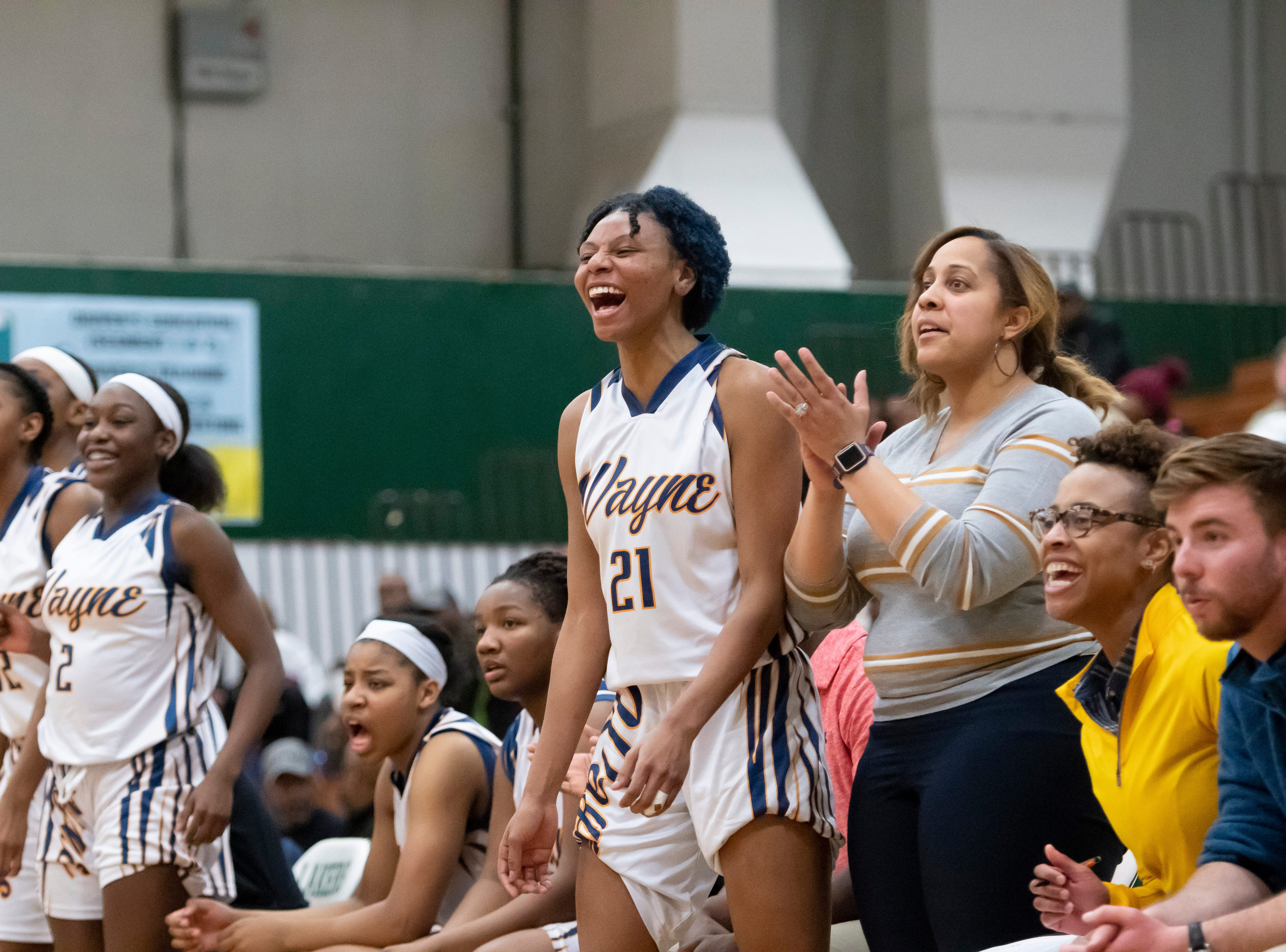 Wayne Memorial guard Sammiyah Hoskin, center, and the rest of the team celebrate after scoring in the second half.
