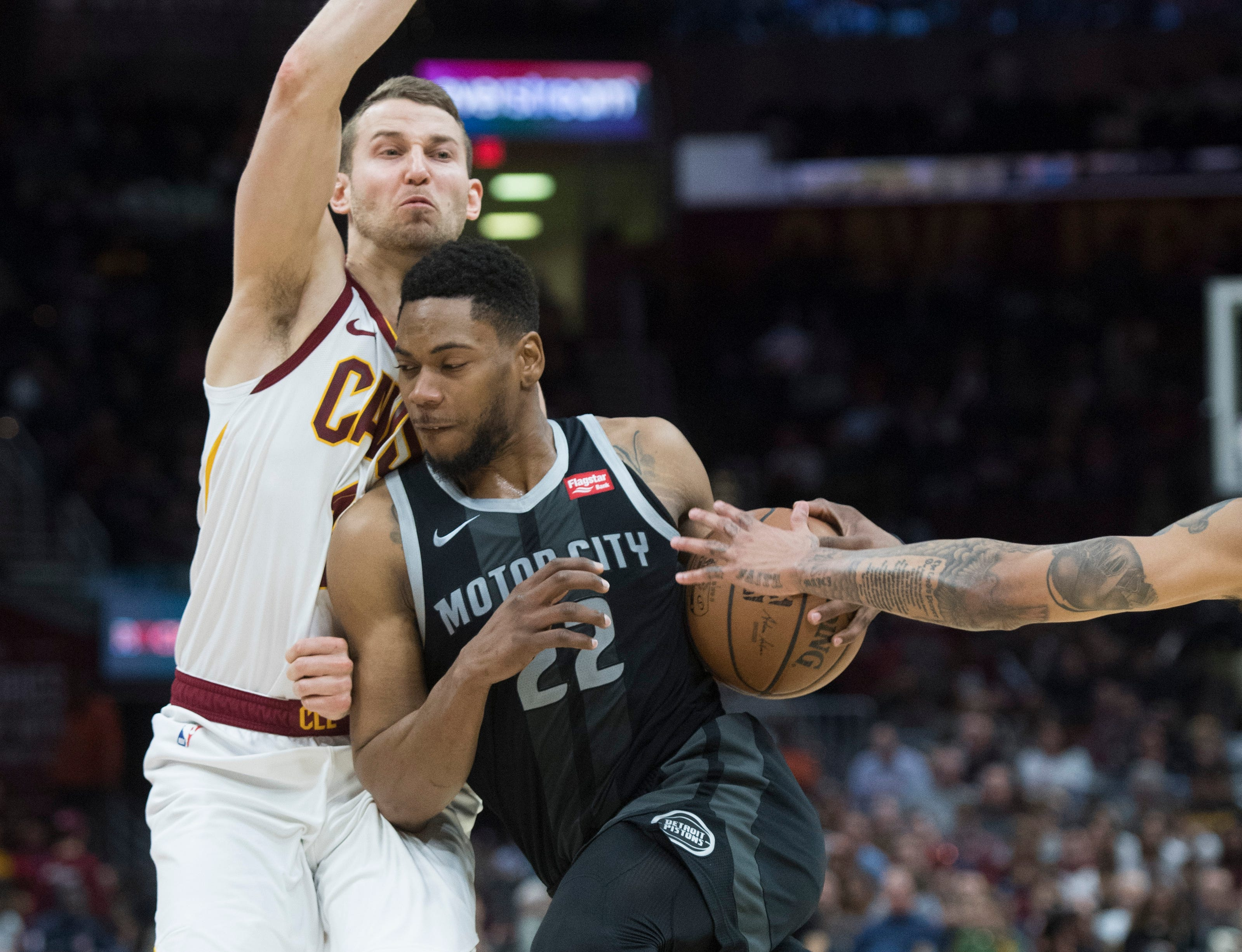 Detroit Pistons' guard Glenn Robinson III, right, drives to the basket against Cleveland Cavaliers' guard Nik Stauskas in the second half of an NBA basketball game.