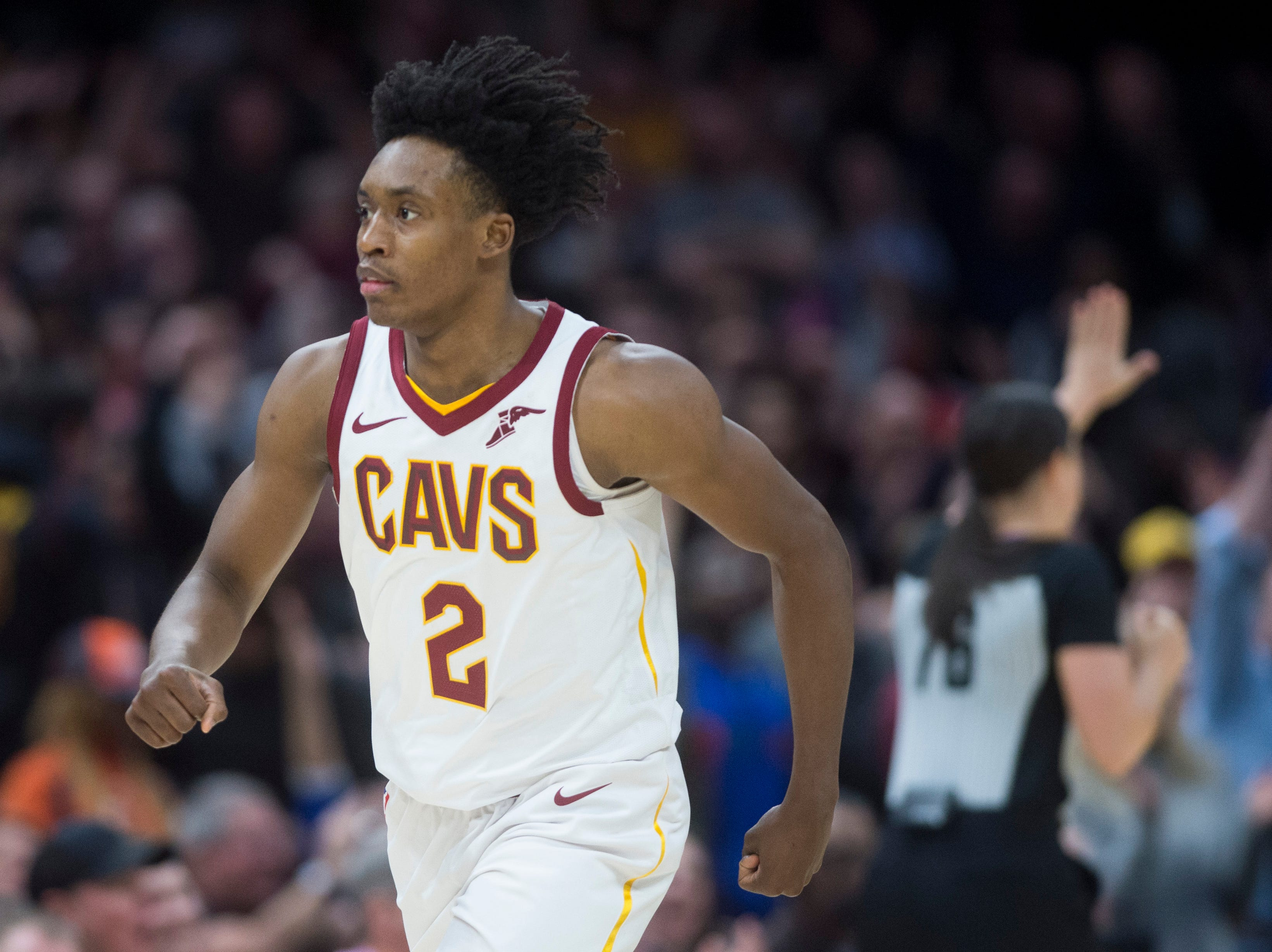 Cleveland Cavaliers' guard Collin Sexton reacts after hitting a three-point basket in the second half of an NBA basketball game.