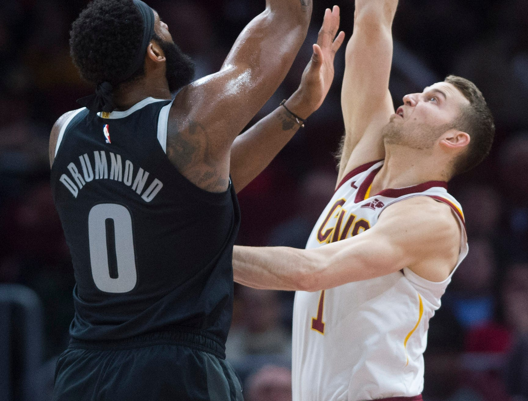 Detroit Pistons' center Andre Drummond shoots over Cleveland Cavaliers' guard Nik Stauskas in the first half of an NBA basketball game.