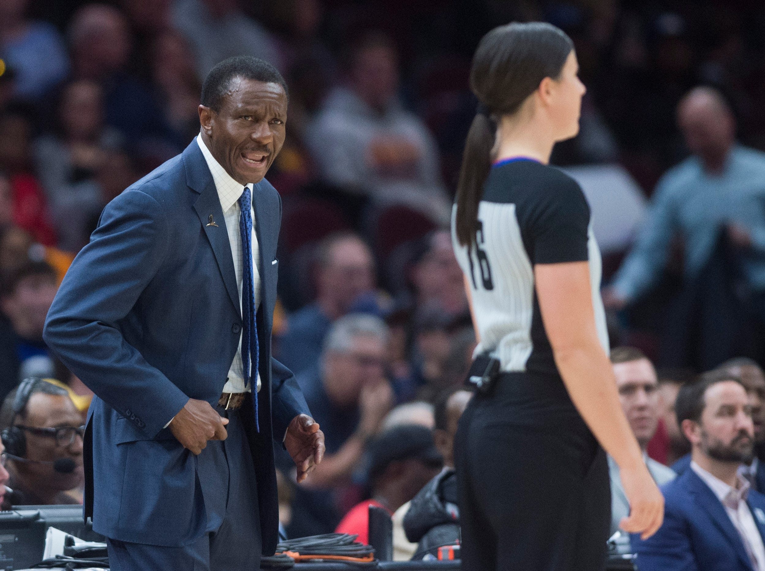Detroit Pistons head coach Dwane Casey, left, yells at referee Natalie Sago after a foul call in the second half of an NBA basketball game against the Cleveland Cavaliers.