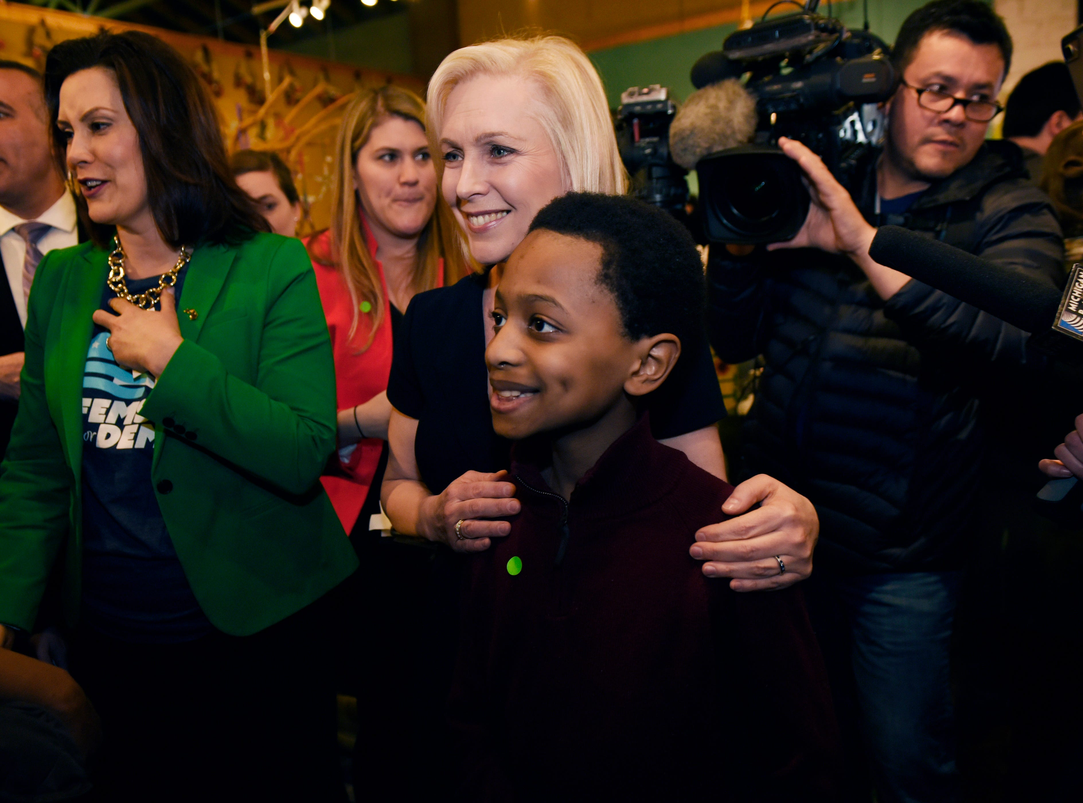 Presidential candidate Kristen Gillibrand,  center, takes a selfie with 10-year-old Grayson Smith of Beverly Hills. Grayson asked Mrs. Gillibrand what she will do about the immigration issue.