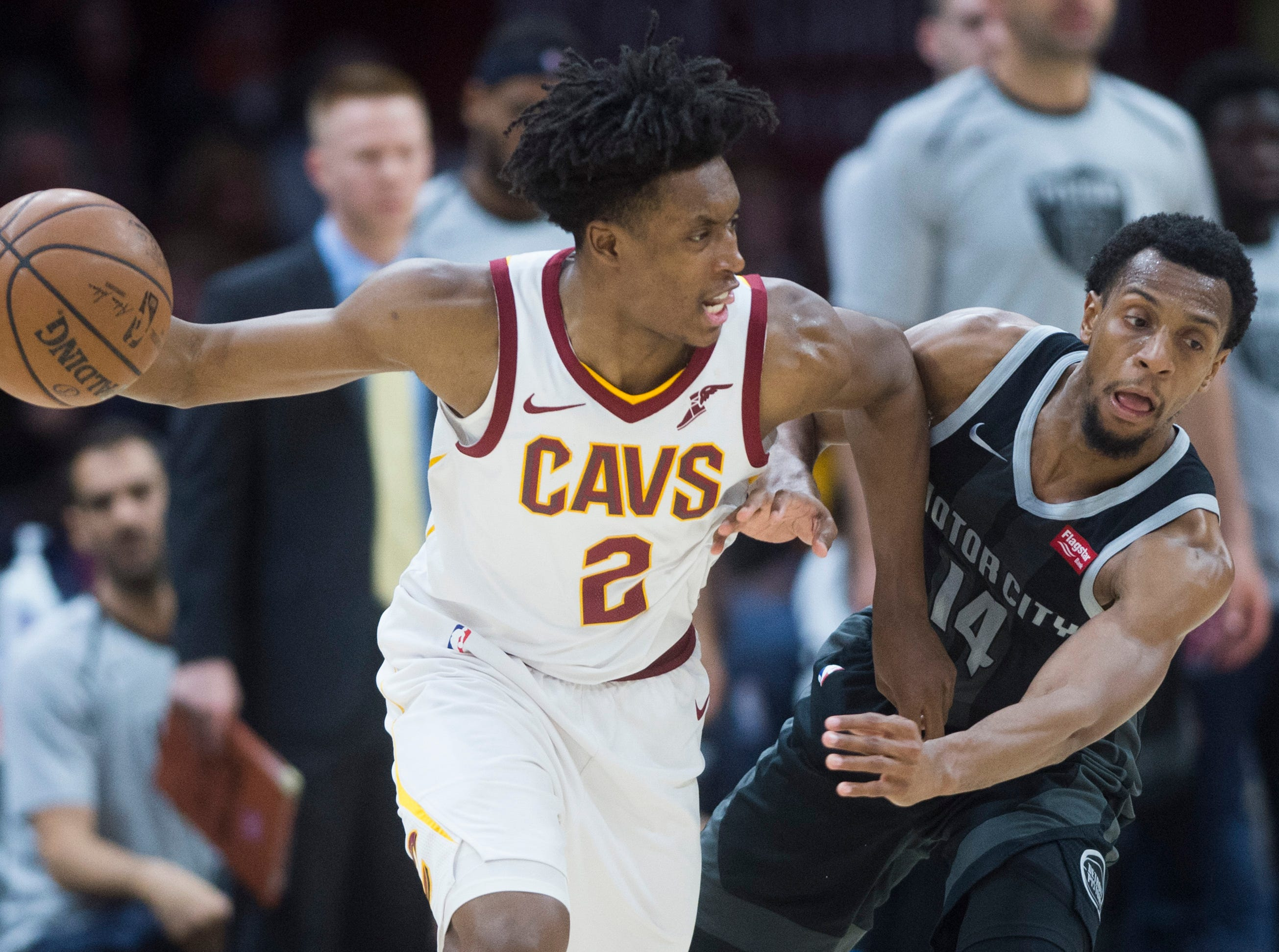 Detroit Pistons guard Ish Smith (14) defends against Cleveland Cavaliers guard Collin Sexton in the second half of an NBA basketball game.