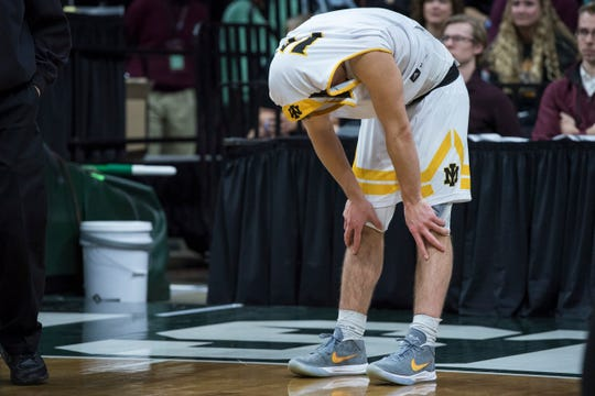 Iron Mountain's Marcus Johnson reacts after his team's loss in the Division 3 boys basketball state title game.