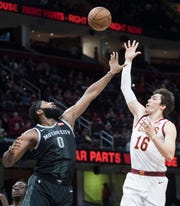 Cleveland Cavaliers' forward Cedi Osman shoots over the defense of  Pistons' center Andre Drummond in the first half.