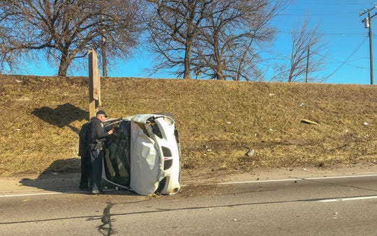 An overturned car on Interstate 94 near Chalmers.
