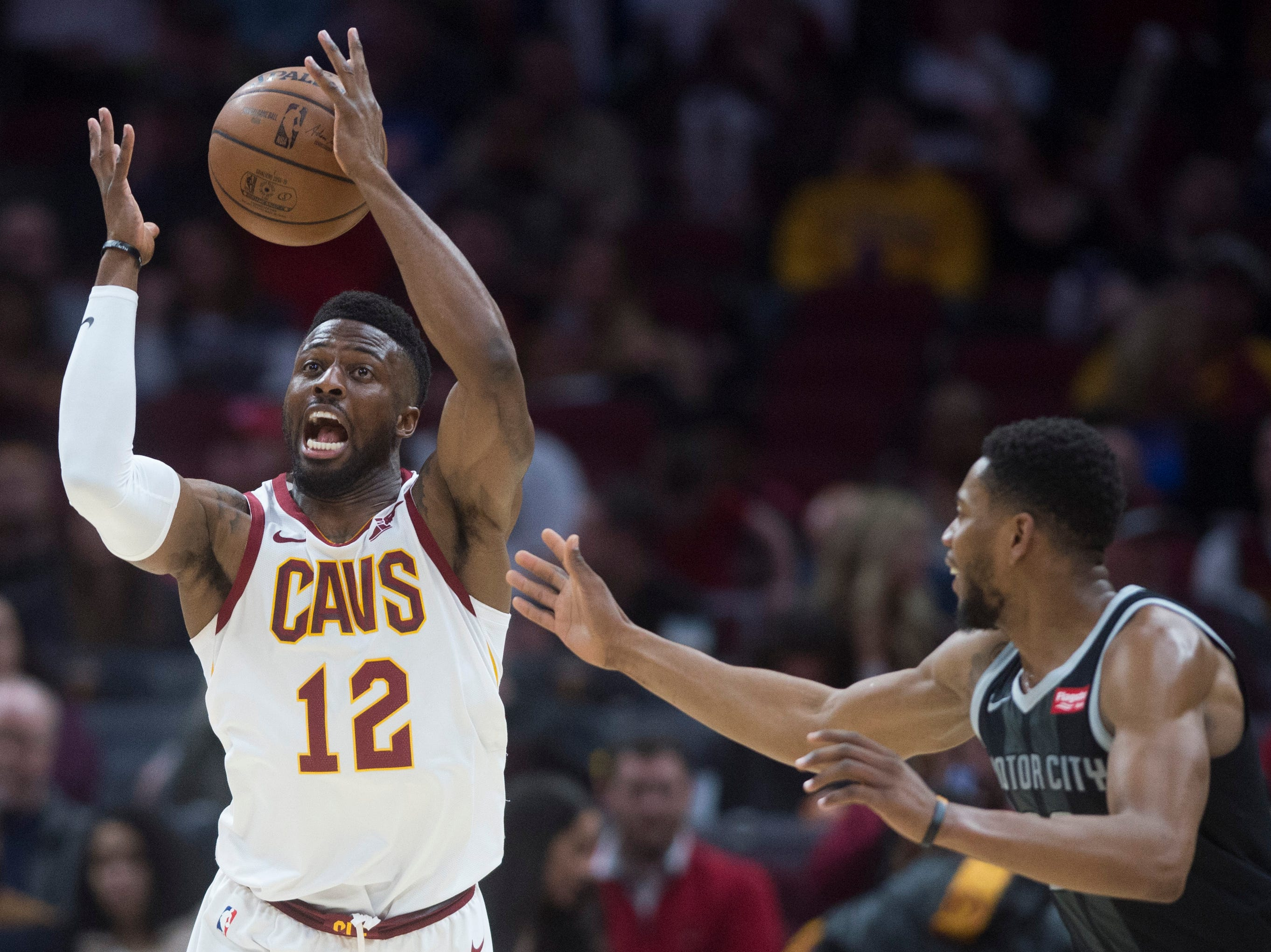 Cleveland Cavaliers guard David Nwaba loses the handle on the ball as Detroit Pistons guard Glenn Robinson III defends in the first half of an NBA basketball game.