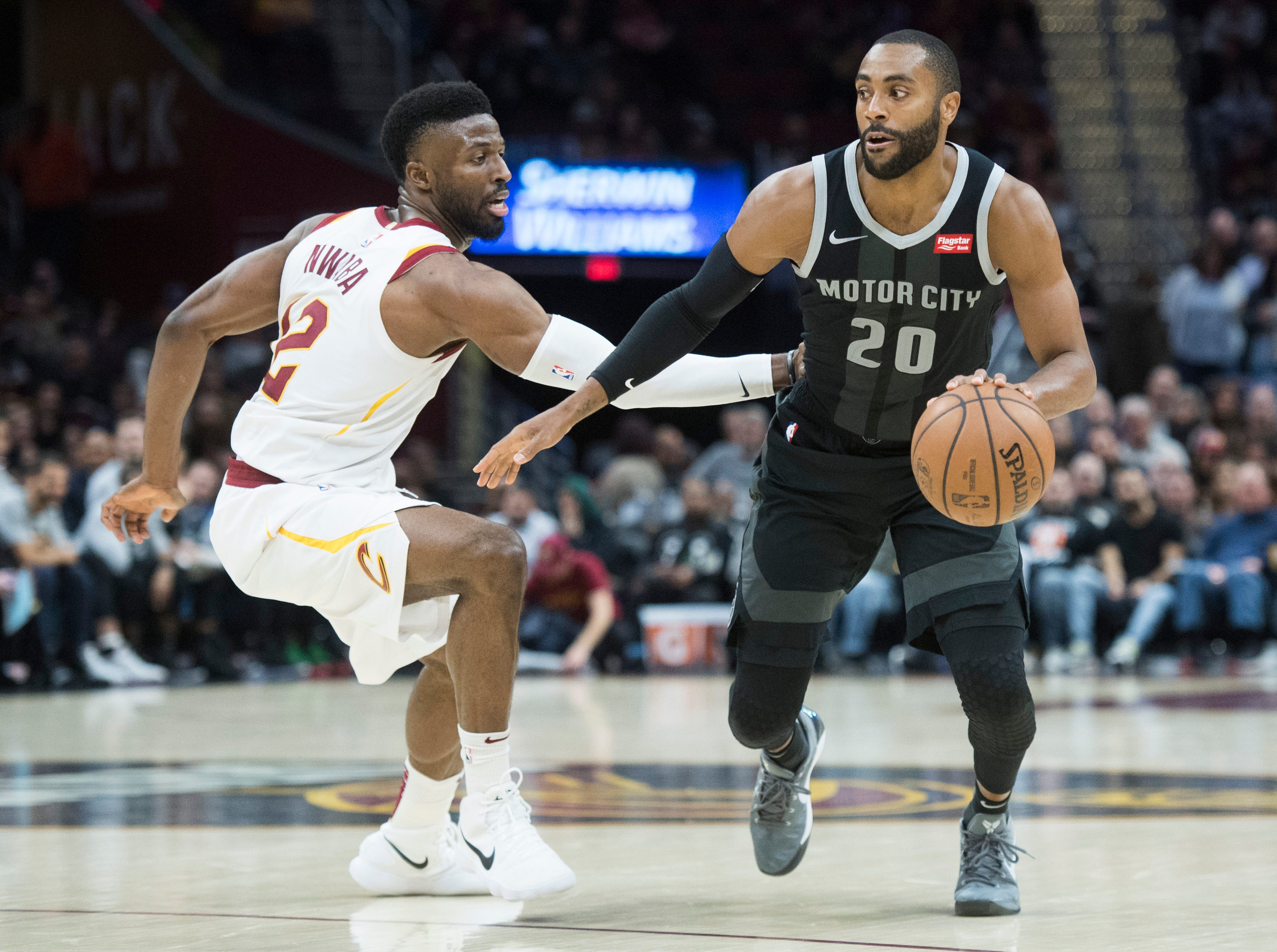 Detroit Pistons' guard Wayne Ellington drives to the basket against Cleveland Cavaliers' guard David Nwaba in the second half of an NBA basketball game.