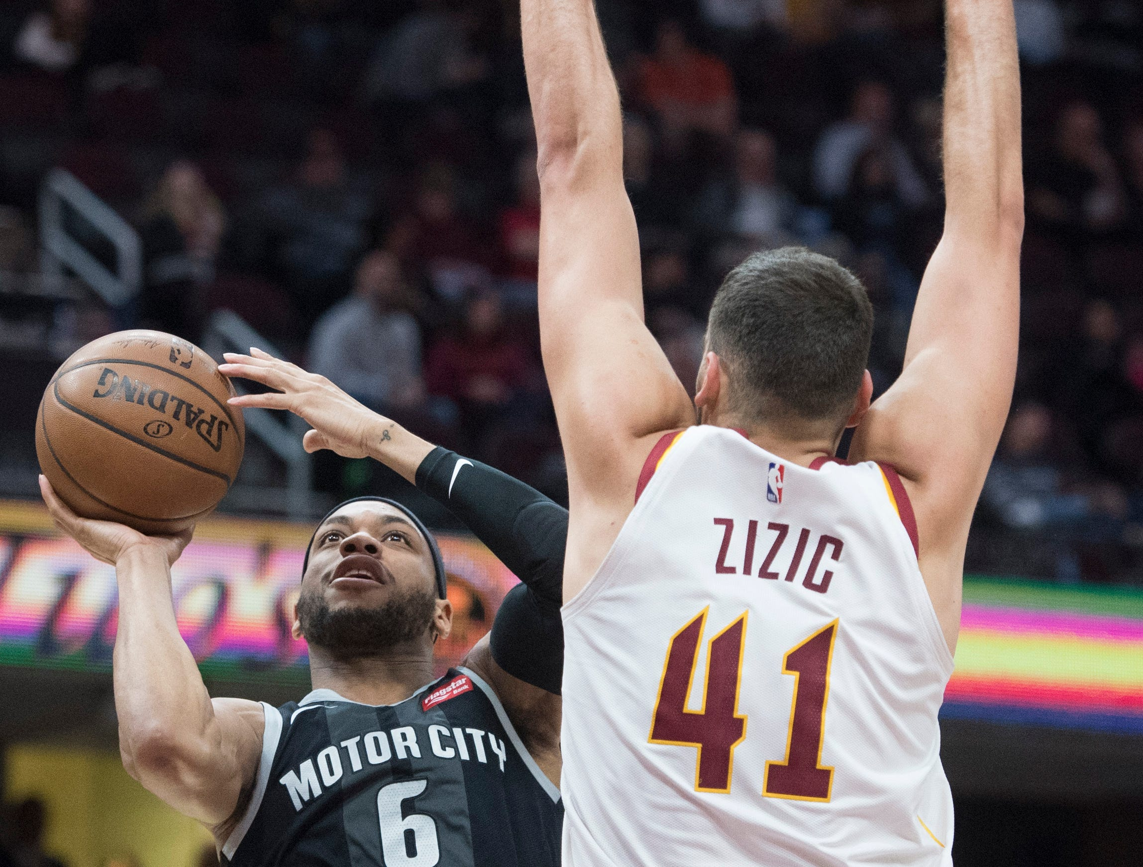 Detroit Pistons guard Bruce Brown (6) shoots as Cleveland Cavaliers center Ante Zizic, from Croatia, defends in the second half of an NBA basketball game.