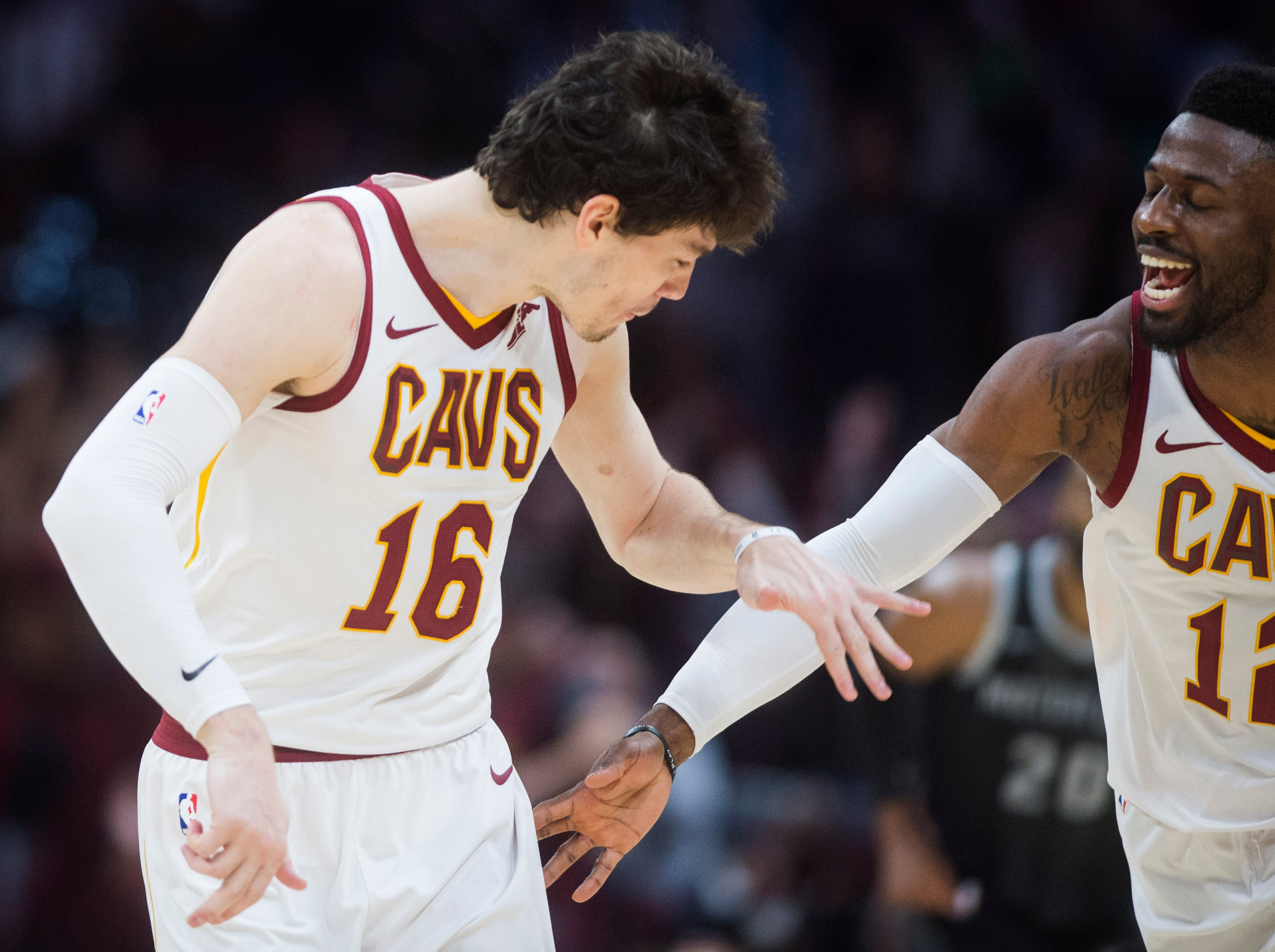 Cleveland Cavaliers' forward Cedi Osman, from Turkey, celebrates with guard David Nwaba after hitting a three-point basket in the second half of an NBA basketball game.