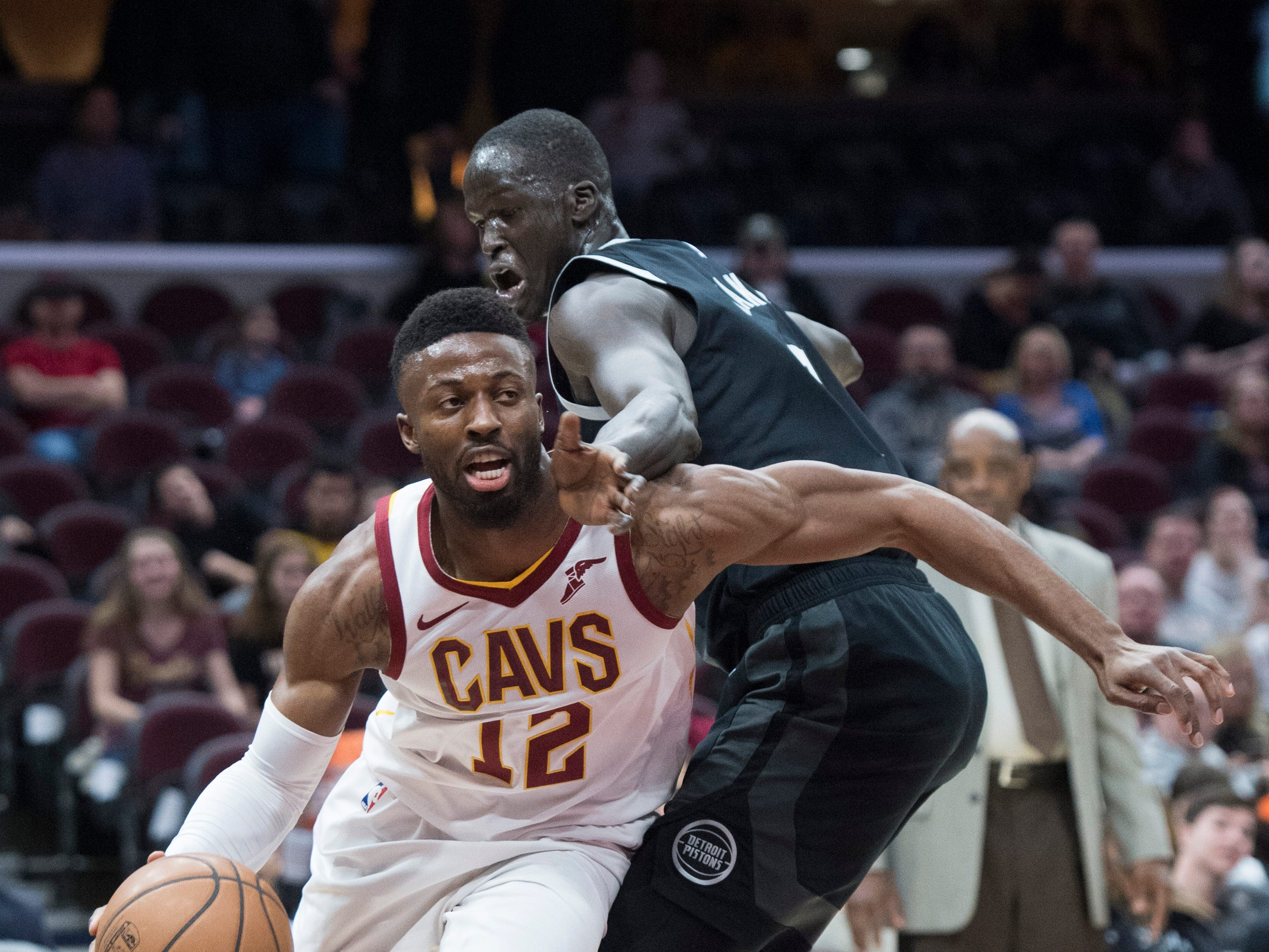 Cleveland Cavaliers' guard David Nwaba drives to the basket against Detroit Pistons' forward Thon Maker, from Australia, in the first half of an NBA basketball game.