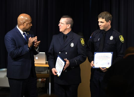 Paramedics Robert Carlton and Joseph Szalay receive recognition Tuesday from Detroit Fire Commissioner Eric Jones for saving three individuals that were exposed to high levels of carbon monoxide.