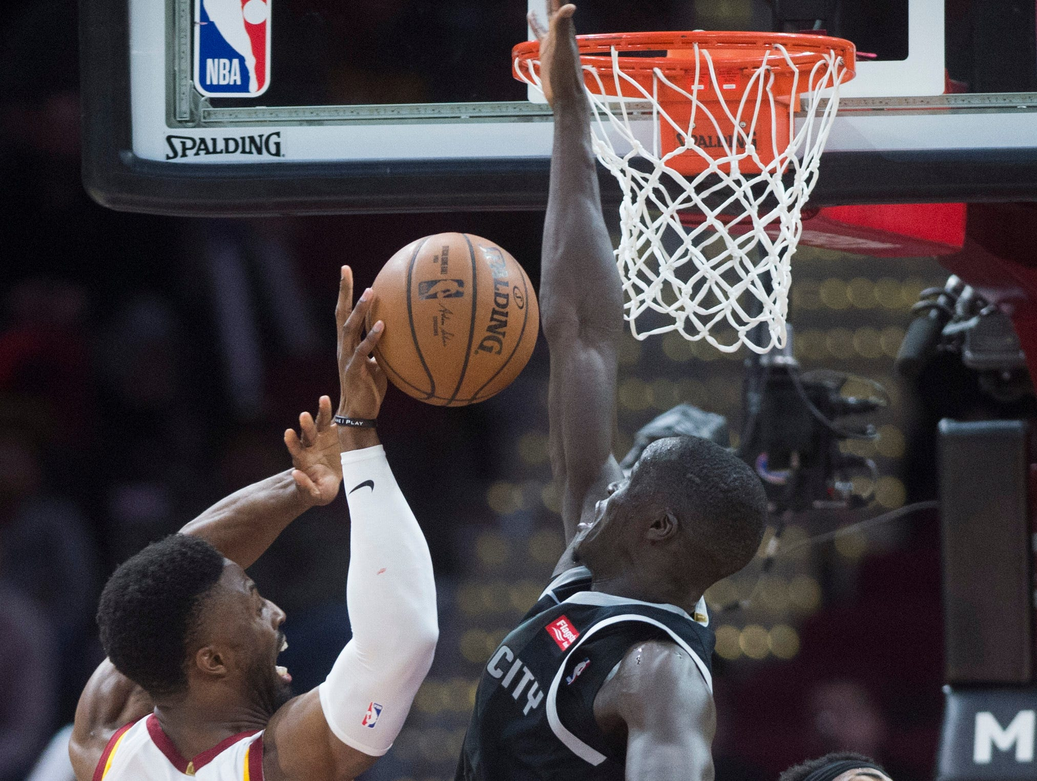 Detroit Pistons' forward Thon Maker, center, of Australia, blocks the shot of Cleveland Cavaliers' guard David Nwaba, left, as Detroit Pistons' center Andre Drummond falls in the second half of an NBA basketball game.