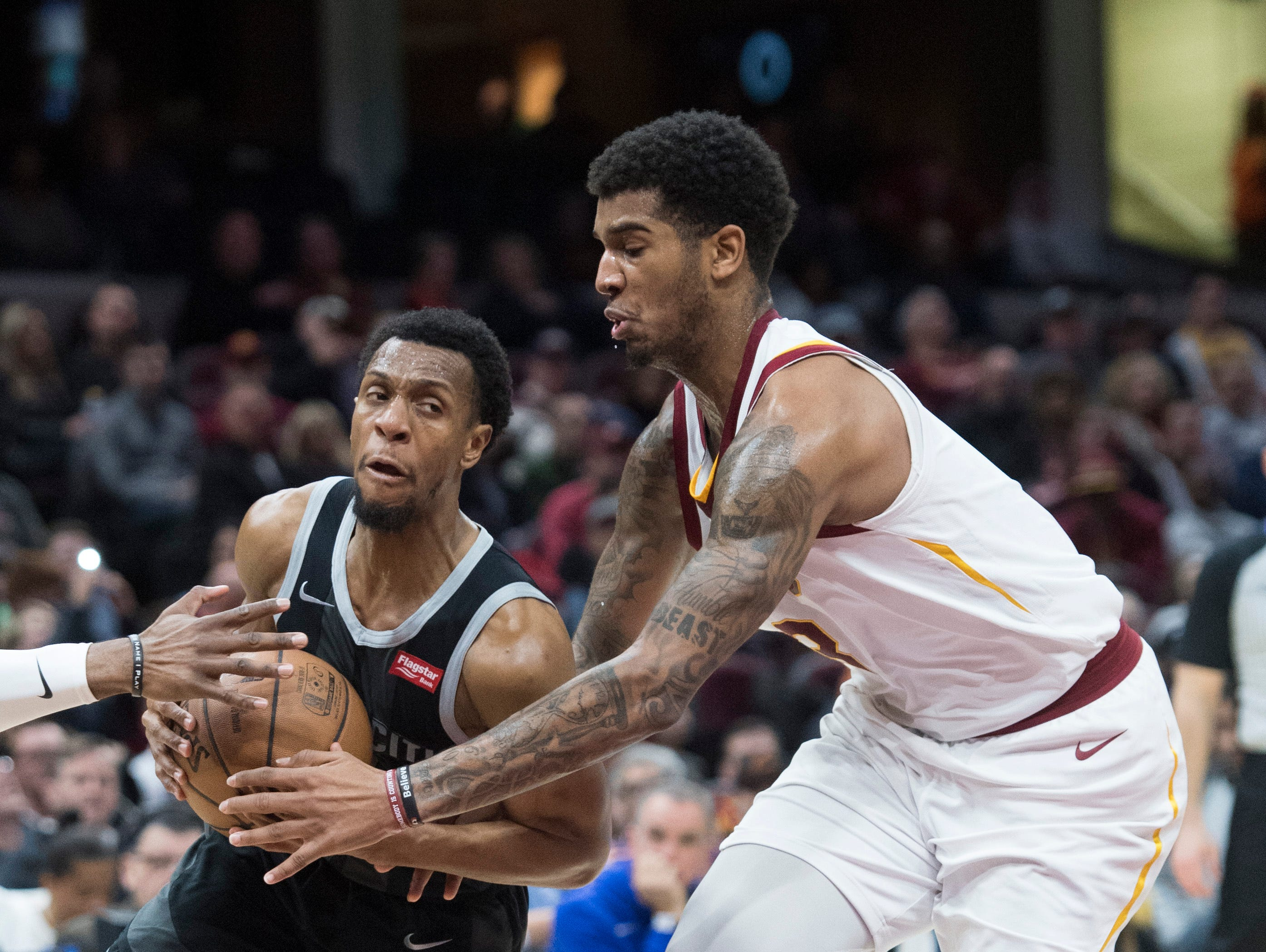 Detroit Pistons guard Ish Smith, left, drives to the basket against Cleveland Cavaliers forward Marquese Chriss in the second half of an NBA basketball game.