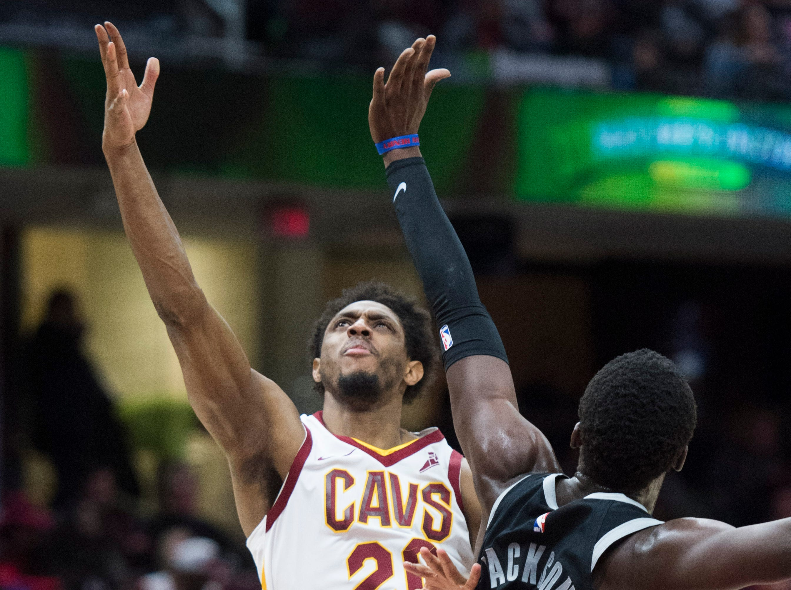 Cleveland Cavaliers' guard Brandon Knight drives to the basket against Detroit Pistons' guard Reggie Jackson, from Italy, in the first half of an NBA basketball game,