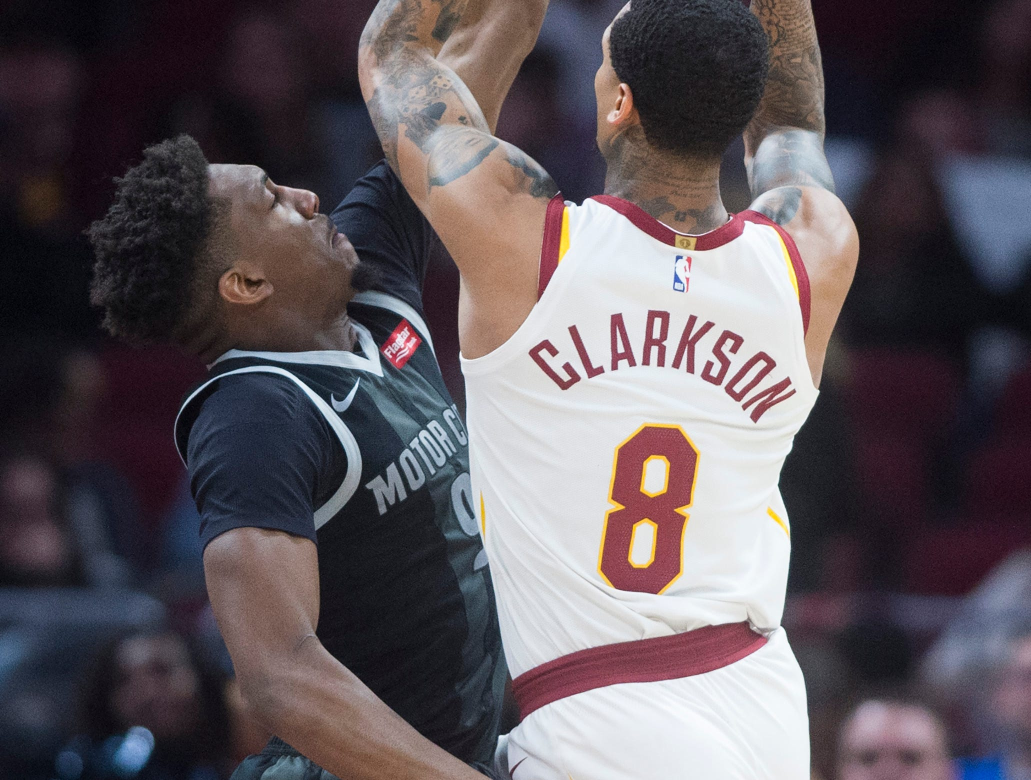 Detroit Pistons' guard Langston Galloway defends against Cleveland Cavaliers' guard Jordan Clarkson in the second half of an NBA basketball game.