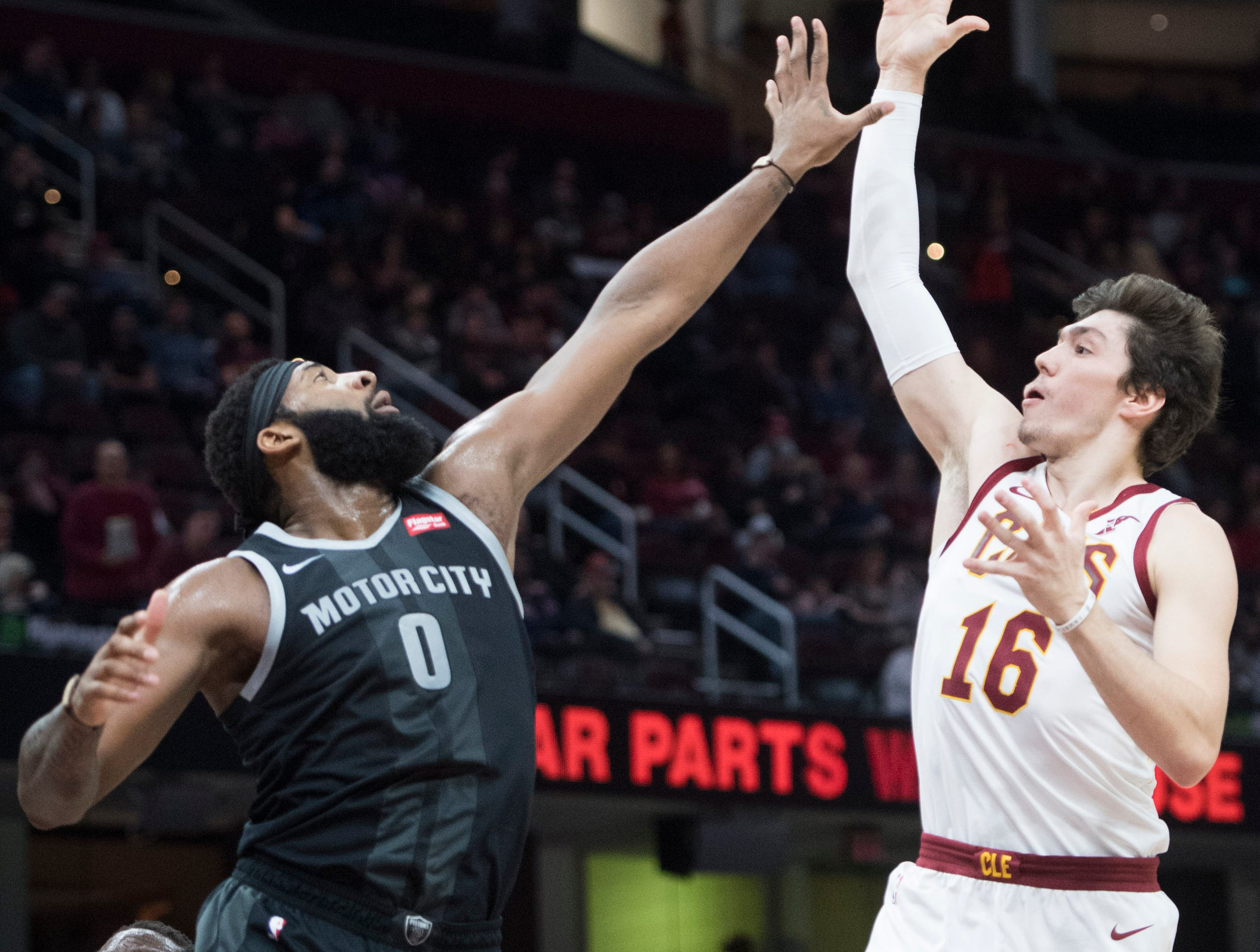 Cleveland Cavaliers' forward Cedi Osman, from Turkey, shoots over the defense of Detroit Pistons' center Andre Drummond in the first half of an NBA basketball game,