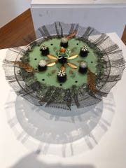 """Nina Cambron's fused-glass """"Cake Topper"""" at the Janice Charach Gallery."""