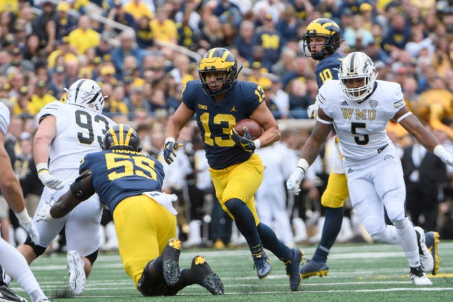 Tru Wilson (13) is part of a running back group that has impressed head coach Jim Harbaugh so far.