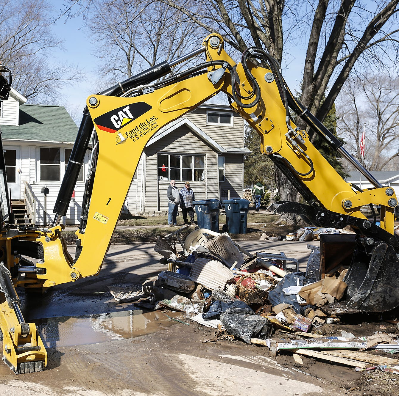 Layers of mud and chaos: Fond du Lac residents clean up after flood devastation