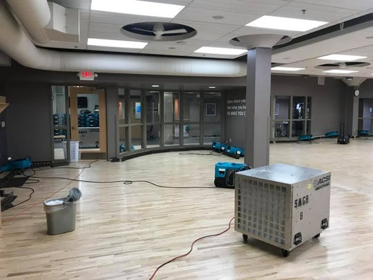 Clean-up continues in the Fond du Lac Family YMCA on Tuesday, March 19.