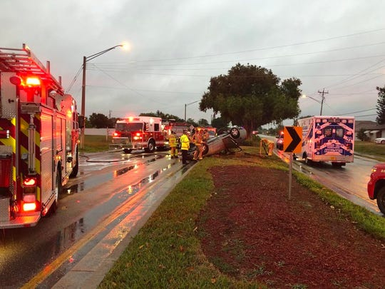 Cape Coral police and fire departments assist a motorist in a rollover crash Tuesday morning.