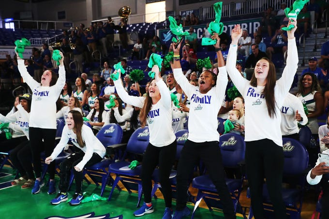 Members of the Florida Gulf Coast University Women's basketball team react to a video recording at a watch party for the NCAA tournament at Alico Arena on the FGCU campus on Monday 3/18/2019.  Players from right are Alyssa Blair, Keri Jewett-Giles, Chandler Ryan, Lisa Zderadicka, Sheahen Dowling. They are the #13 seed and will play Miami on Friday.