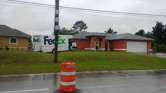 A FedEx truck left the road on Embers Parkway near Del Prado Boulevard N in Cape Coral, hitting the corner of a home on Tuesday, March 19, 2019.