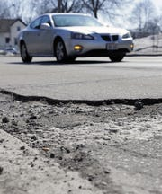 A driver avoids a torn-up stretch of Shawano Avenue on March 19 in Green Bay.