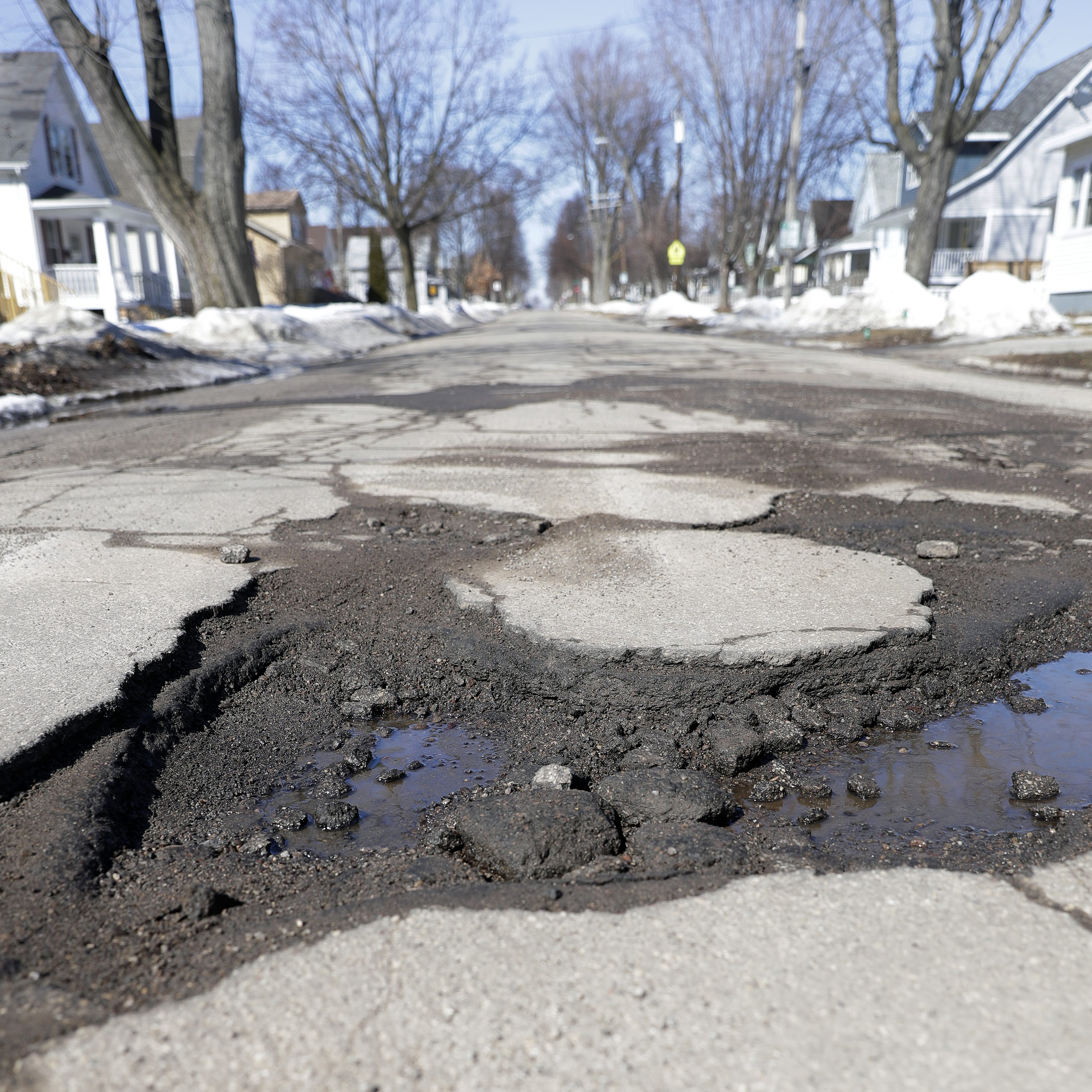 The snow is melting, but now we're dodging potholes around Green Bay