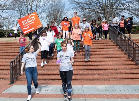 Participants walk through Clemson University for the Out of the Darkness Clemson University Campus Walk Saturday, Mar. 2, 2019.