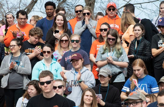 Participants in the Out of the Darkness Clemson University Campus Walk listen to speakers at North Green Saturday, Mar. 2, 2019.