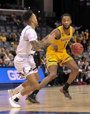 Markis McDuffie (1) leads Wichita State into Timmons Arena on Wednesday.