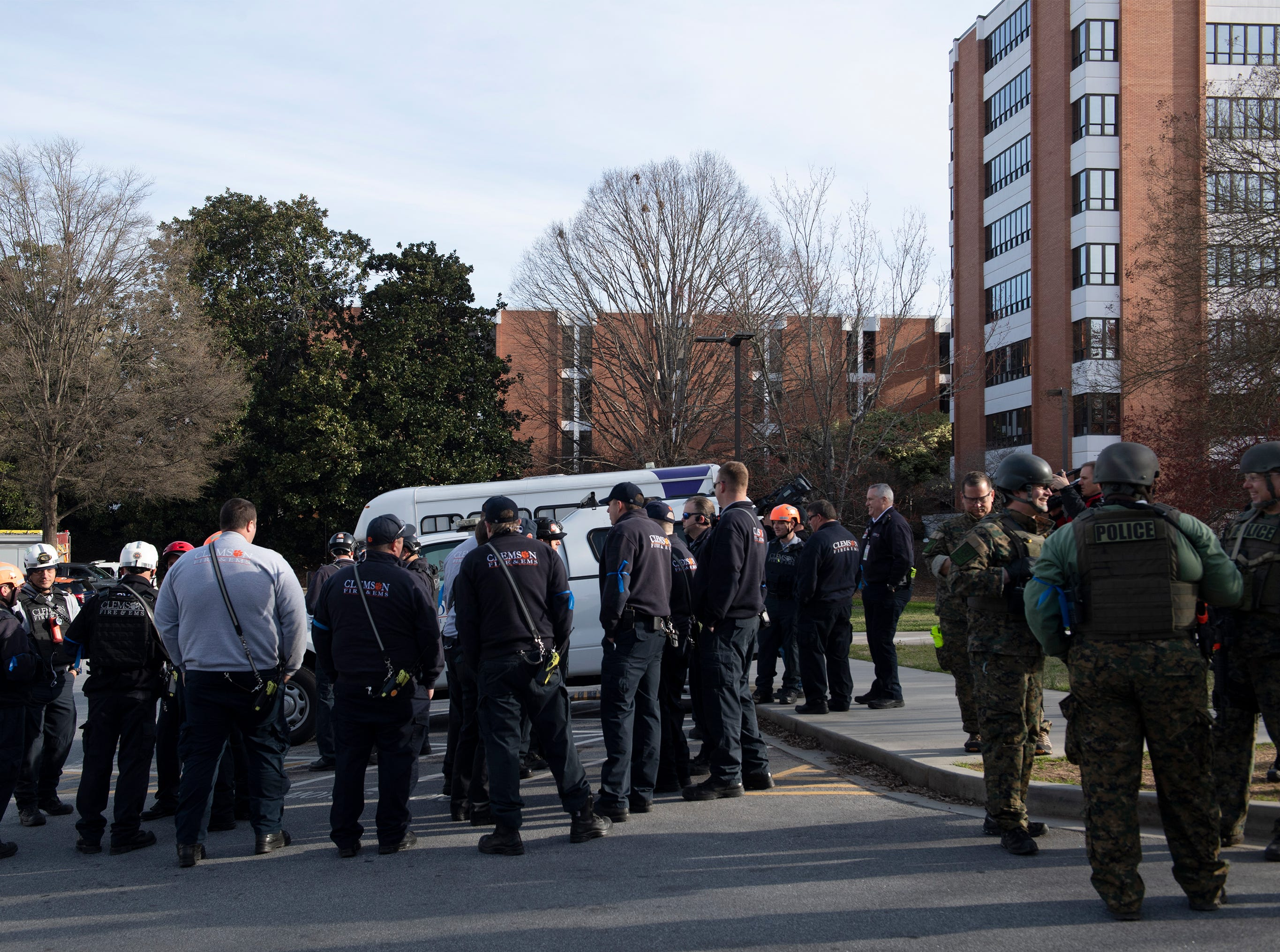Emergency personnel from Clemson University and surrounding areas gather outside Daniel Hall before the start of an active shooter exercise Tuesday, Mar. 19, 2019.