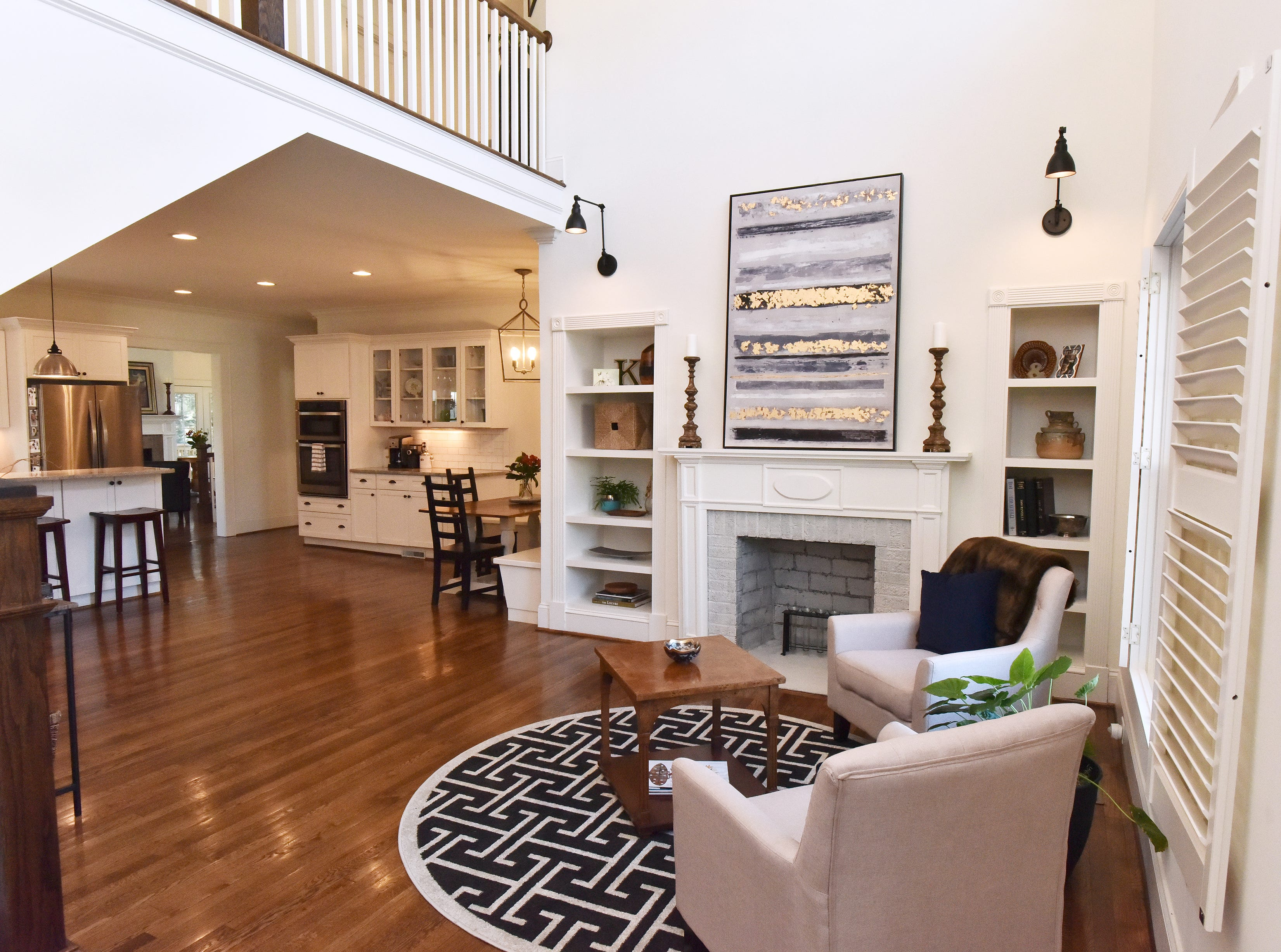 An open floor plan that features the living room, kitchen, and small dining area.