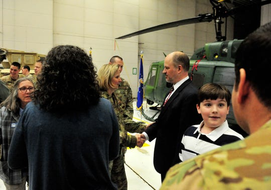 Colonel Jennifer Reeves, commander of the 341st Missile Wing, shakes hands with Judge John Parker after a recognition ceremony to honor 14 airmen who were involved in several civilian rescues this winter, including Parker's rescue.  A helicopter from Malmstrom's 40th Helicopter Squadron was deployed on a search and rescue mission after Parker became stranded in subzero degree weather in early March.