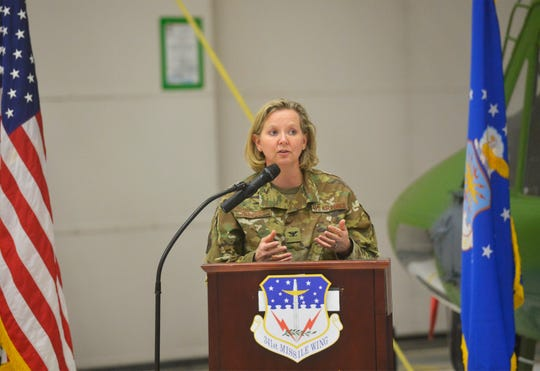 Commander of the 341st Missle Wing, Colonel Jennifer Reeves honors 14 airmen on Tuesday morning at Malmstrom Air Force Base for their actions in civilain rescues this winter.