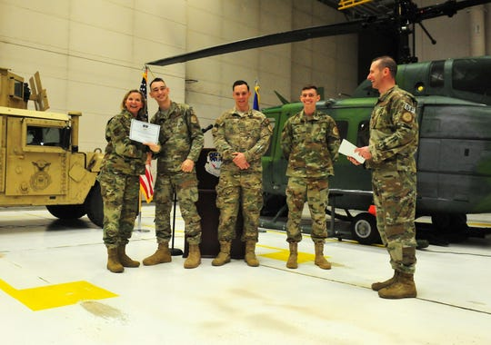 Commander of the 341st Missle Wing, Colonel Jennifer Reeves honors airmen from left to right: Senior Airman Tyler Shepherd, Senior Airman William English and Airman 1st Class Andrew Page for their February 20th rescue of a motorist involved in a rollover crash.  Several groups of airmen were recognized on Tuesday morning at Malmstrom Air Force Base for civilian rescues this winter.