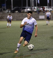 Guam Shipyard's Damien Khoo controls the ball in the midfield against Manhoben Lalahi in a Week 16 match of the Budweiser Soccer League Premier Division Saturday at the Guam Football Association National Training Center. Manhoben Lalahi defeated Guam Shipyard 5-2.