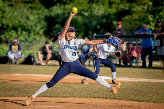 Ashley Mendiola of the Academy of Our Lady of Guam delivers a pitch against a Guam High tatter during the IIAAG Girls Softball championship held at Okkodo High School on March 18.