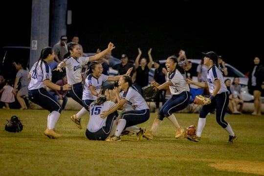 The Academy of Our Lady of Guam celebrates after winning the IIAAG Girls Softball championship against Guam High in this March 18 file photo. The Interscholastic Sports Association's girls softball league is expected to have both public and private school teams participating.