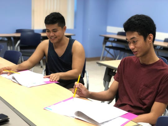 """Edward Carter Taimanao and Nhel Patrick Cosby rehearse for their scene in """"Enamored."""" The actors will be joined by other local artists and performers at the UOG Fine Arts Theatre March 22 - 24 in a two-part production from Breaking Wave Theatre Company."""