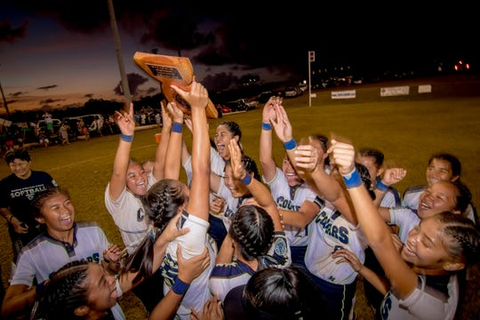 Academy of Our Lady of Guam celebrates after winning the IIAAG Girls Softball championship match against Guam High in this March 18 file photo.