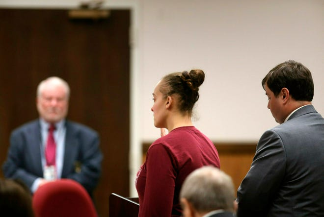 Cassie Barker, an ex-Long Beach police officer, pleads guilty to manslaughter in Harrison County Circuit Court in Gulfport, Miss., on Monday, March 18, 2019. Barker tells a judge she had sex with a then-supervisor and then fell asleep in September 2016 while her 3-year-old daughter, Cheyenne Hyer, was dying in an overheated police car.