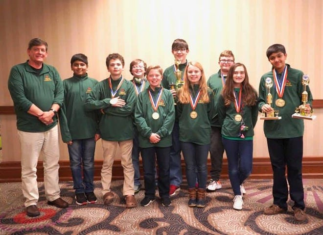 Holy Name School's Quick Recall team finished as a quarter-finalist in the Governor's Cup state tournament hosted at the Galt House hotel March 16-18. Shaurya Jadhav, far right, also placed fifth individually in Mathematics and Science.