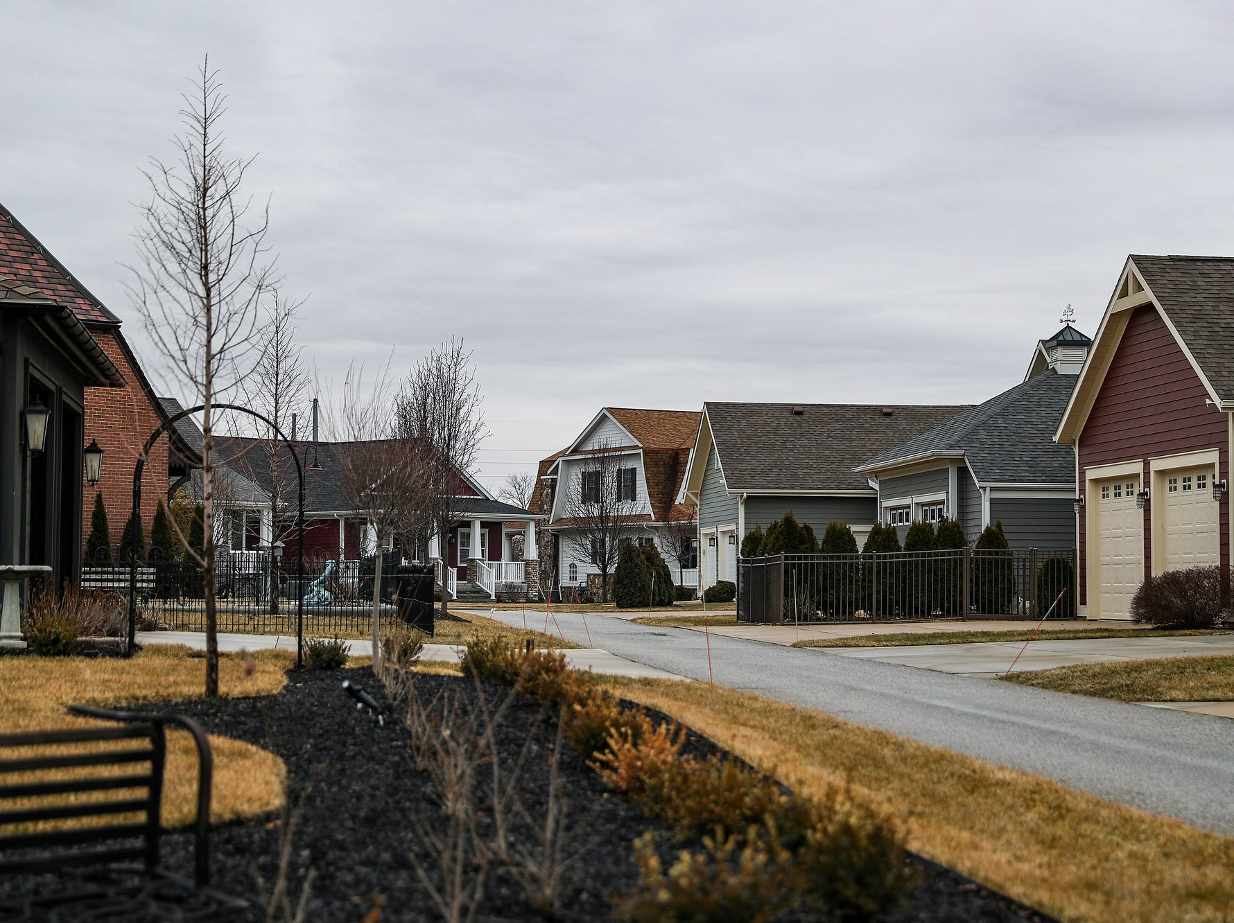 Tightly spaced homes line the streets of The Triangle residential district, a new neighborhood that has sprung up near Notre Dame campus, March 13, 2019. Mayor Pete Buttigieg says $852 million in private investment has been spent on city-incentivized deals since he's been in office. New houses and commercial development are quickly on the rise near the university.